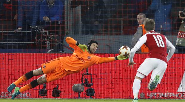 Arsenal's goalkeeper Petr Cech feels winning the Europa League would help the club move forward (Pavel Golovkin/AP)