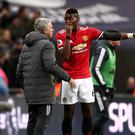 Manchester United boss Jose Mourinho, left, wants midfielder Paul Pogba to be more consistent