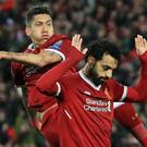 Mohamed Salah, right, celebrates with Roberto Firmino after his second goal