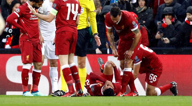 A potentially-serious injury to Liverpool's Alex Oxlade-Chamberlain marred a 5-2 Champions League semi-final first-leg win over Roma