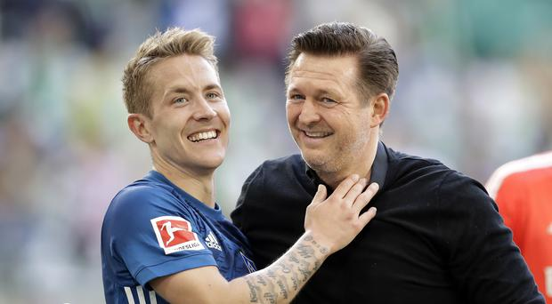Christian Titz (right) celebrates with Lewis Holtby after beating Wolfsburg