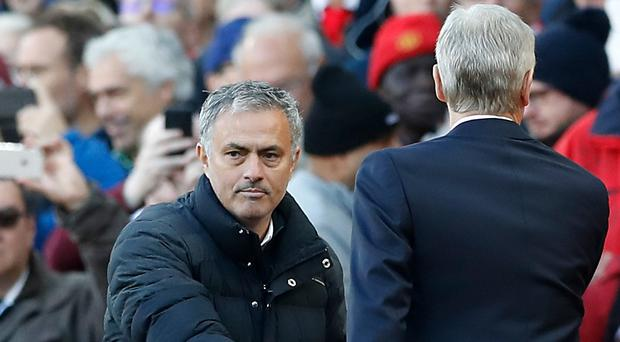 Jose Mourinho (left) and Arsene Wenger will meet again on Sunday