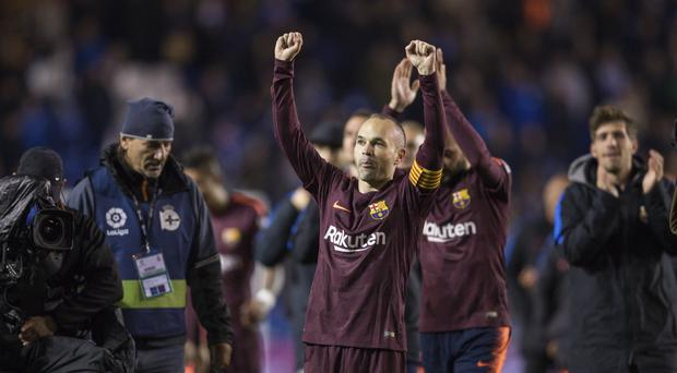 Andres Iniesta (centre) celebrates his ninth LaLiga title