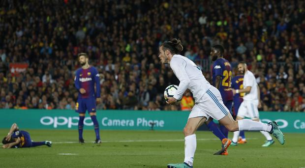 Real Madrid's Gareth Bale scored to earn his side a 2-2 draw with Barcelona (Manu Fernandez/AP)