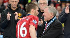 Manchester United captain Michael Carrick has sent his best wishes to seriously ill former manager Sir Alex Ferguson (right).