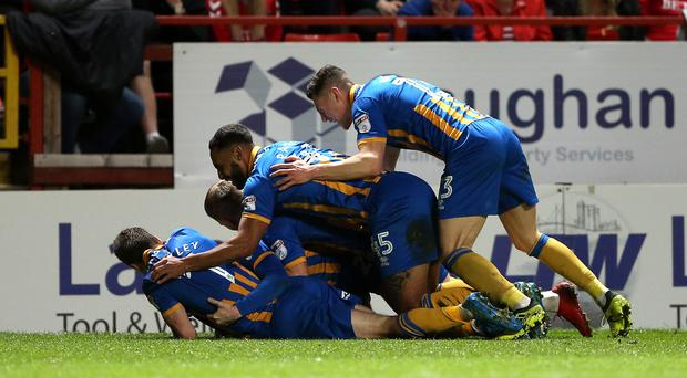 Shrewsbury Town's Joe Nolan (hidden) celebrates