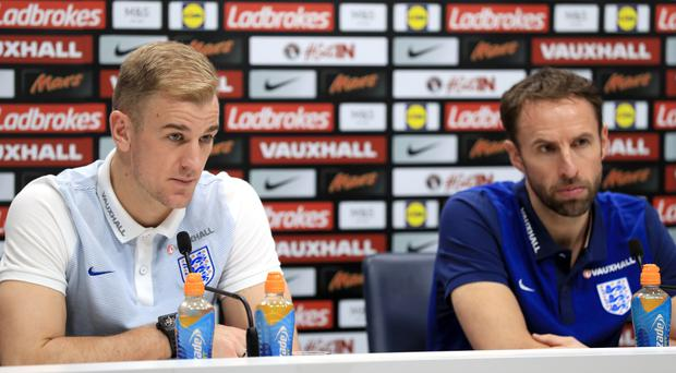 England manager Gareth Southgate (right) is expected to leave experienced goalkeeper Joe Hart (left) out of his 23-man World Cup squad. (Adam Davy/PA Images)