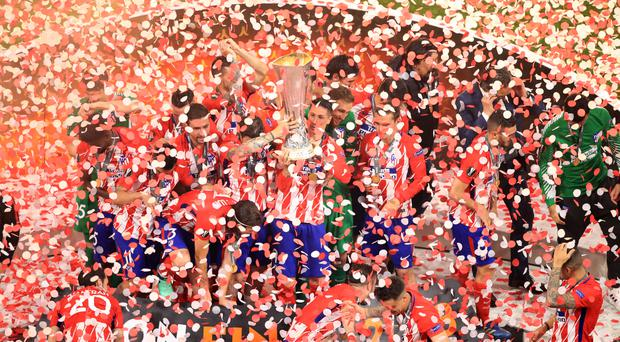 Atletico Madrid's Fernando Torres lifts the trophy as Atletico Madrid celebrate winning the Europa League