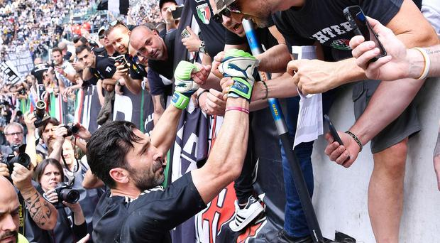 Gianluigi Buffon greets Juventus supporters ahead of his final match for the club (Alessandro Di Marco/AP)
