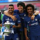 Willian (right) celebrates winning the FA Cup with Emerson Palmieri (left) and David Luiz (centre)