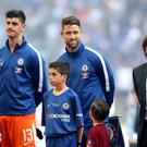 Gary Cahill, second right, hopes for a swift answer on the future of Antonio Conte, right, as head coach