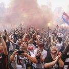 Eintracht Frankfurt fans celebrate their club winning the German Cup - (Frank Rumpenhorst/AP)