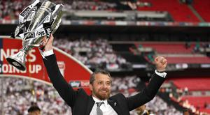Slavisa Jokanovic lifts the Championship play-off trophy