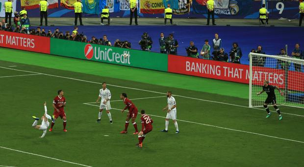 Gareth Bale, left, scores Real Madrid's second goal