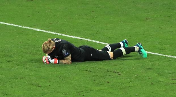 Karius lies dejected on the pitch after the final whistle in Kiev