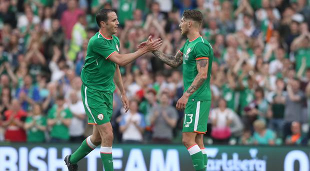 John O'Shea ended his international career with a victory (Brian Lawless/PA)