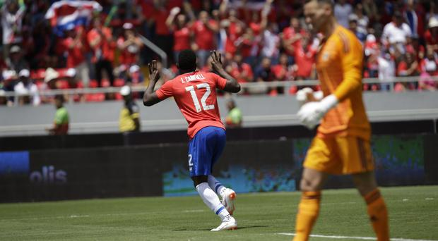 Joel Campbell, centre, celebrates his goal (Moises Castillo/AP)