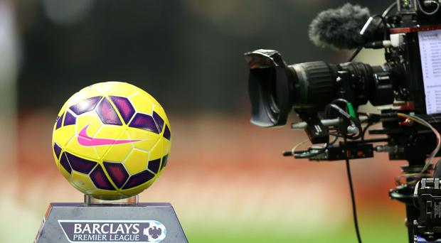 British football fans who want access to every live Premier League match from 2019-22 will have to pay Amazon, BT and Sky for the privilege (Peter Byrne/PA)