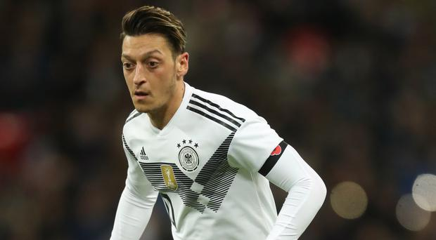 Arsenal midfielder Mesut Ozil picked up a knee problem while on international duty with Germany. (Adam Davy/EMPICS Sport)