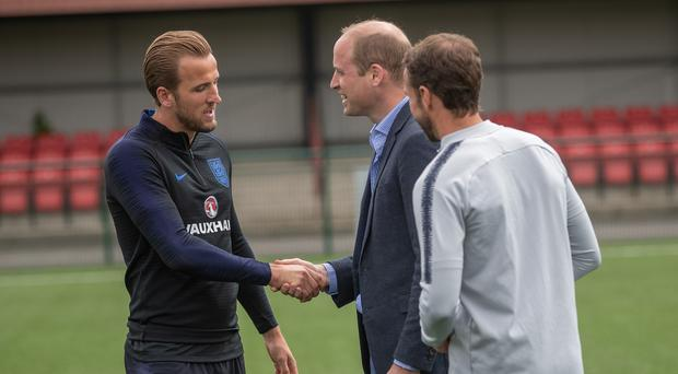 The Duke of Cambridge (centre) with Gareth Southgate and Harry Kane (Charlotte Graham/PA)
