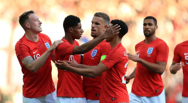 England's Marcus Rashford (second left) celebrates scoring his side's first goal of the game during the International Friendly match at Elland Road, Leeds. (Mike Egerton/PA)