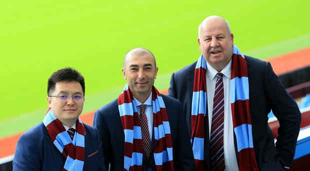 Aston Villa chairman Dr Tony Xia (left) with former manager Roberto Di Matteo and ex-chief executive Keith Wyness. (Tim Goode/PA)