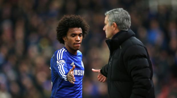 Chelsea's Willian (left) shakes hands with manager Jose Mourinho (Mike Egerton/Empics)