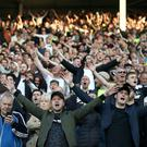 Derby County fans show their support in the stands before the game