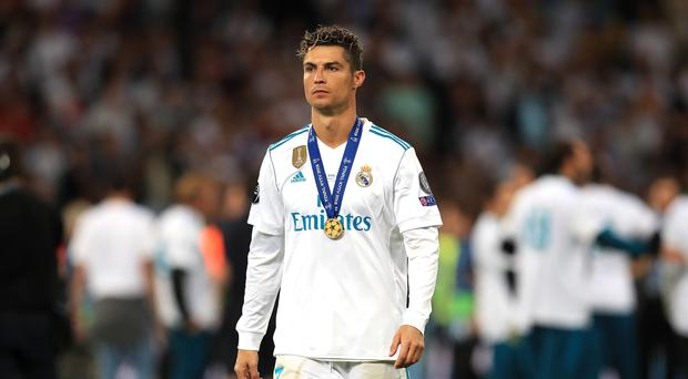 Cristiano Ronaldo is on his way to Juventus (Mike Egerton/PA)
