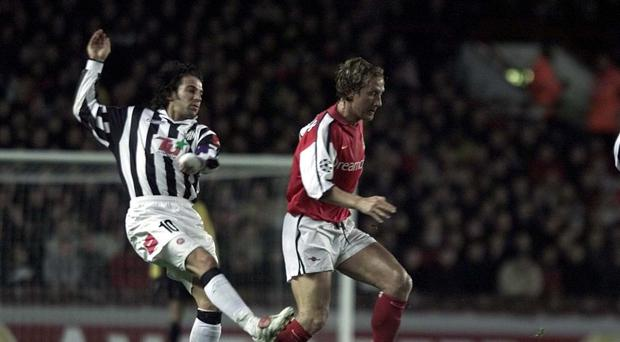 Arsenal's Ray Parlour comes under pressure from Juventus's Alessandro Del Piero in 2001 (Tom Hevezi/PA)