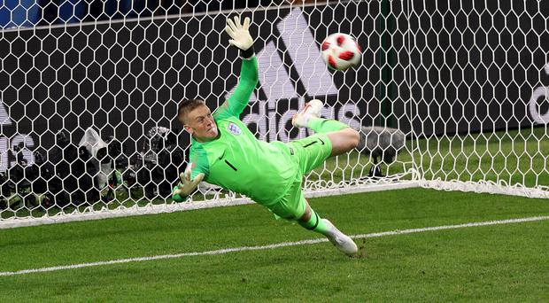 File photo dated 03-07-2018 of England goalkeeper Jordan Pickford saves a penalty from Colombia's Carlos Bacca during the FIFA World Cup 2018, round of 16 match at the Spartak Stadium, Moscow.