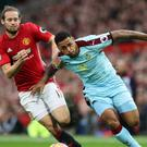 "Burnley's Andre Gray (right) and Manchester United's Daley Blind battle for the ball during the Premier League match at Old Trafford, Manchester. PRESS ASSOCIATION Photo. Picture date: Saturday October 29, 2016. See PA story SOCCER Man Utd. Photo credit should read: Martin Rickett/PA Wire. RESTRICTIONS: EDITORIAL USE ONLY No use with unauthorised audio, video, data, fixture lists, club/league logos or ""live"" services. Online in-match use limited to 75 images, no video emulation. No use in betting, games or single club/league/player publications."