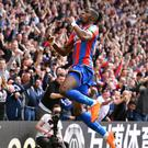 Crystal Palace's Wilfried Zaha celebrates scoring his side's first goal of the game during the Premier League match at Selhurst Park, London.
