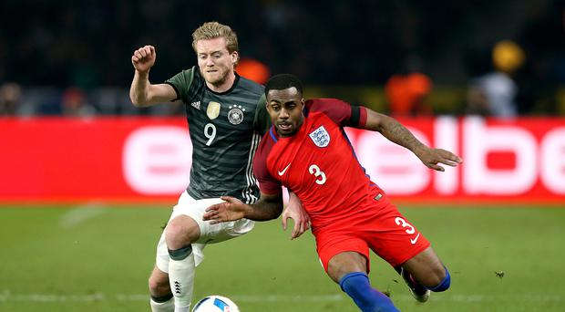 England's Danny Rose and Germany's Andre Schurrle (left) battle for the ball during the International Friendly match at the Olympic Stadium, Berlin.