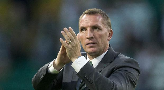 Brendan Rodgers' Celtic are through to the Champions League third qualifying round (Jeff Holmes/PA)