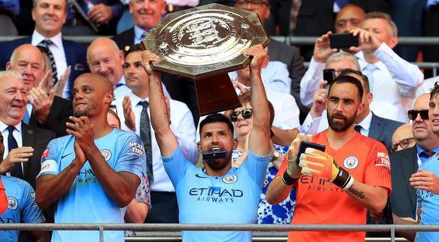 Manchester City's Sergio Aguero lifts the Community Shield trophy (Mike Egerton/PA)