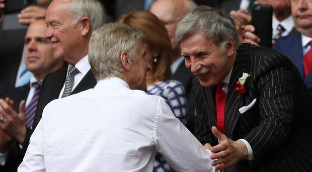 Stan Kroenke (right) was a staunch advocate of former Arsenal boss Arsene Wenger. (Adam Davy/PA)