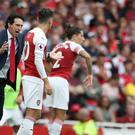 Unai Emery, left, and Mesut Ozil, centre, will be hoping Arsenal can get a result at Chelsea. (Nick Potts/PA)