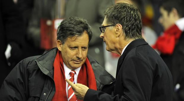 Liverpool chairman Tom Werner (left) and Fenway Sports Group principal owner John Henry are open to a minority investment stake in the club (Martin Rickett/PA).