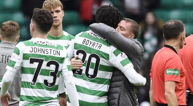 Celtic manager Brendan Rodgers gives goalscorer Dedryck Boyata a hug after the win over Hamilton (Ian Rutherford/PA)