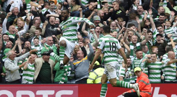 Olivier Ntcham, left, celebrates netting the winner in the Old Firm derby (Jeff Holmes/PA)