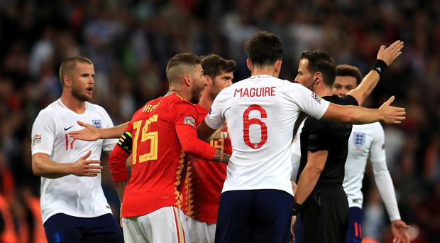 England's players remonstrated with the referee after Danny Welbeck's goal was ruled out (Mike Egerton/PA)