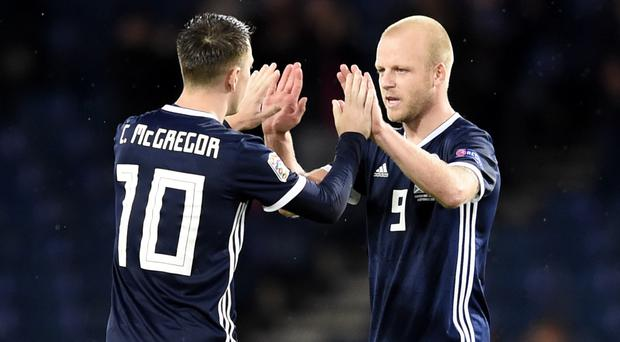 Scotland's Callum McGregor (left) and Steven Naismith celebrate after beating Albania at a half-empty Hampden (Ian Rutherford/PA)