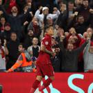 Roberto Firmino celebrates his winner in front of the Anfield crowd (Peter Byrne/PA)