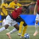 Young Boys' Guillaume Hoarau, back, clashes with Manchester United's Paul Pogba, during their Champions League group H soccer match between Switzerland's BSC Young Boys and England's Manchester United, in the Stade de Suisse in Berne, Switzerland, on Wednesday, Sept. 19, 2018. (Anthony Anex/Keystone via AP)