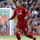 Liverpool's Virgil van Dijk is determined to win trophies with the club (Martin Rickett/PA)