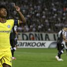 Willian celebrates his early goal (Thanassis Stavrakis/AP)