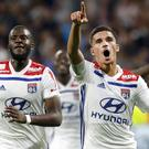 Houssem Aouar, right, scored Lyon's opener in a thrilling win against Marseille (Laurent Cipriani/AP/PA)