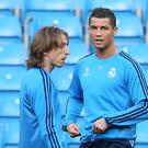 Luka Modric, left, and Cristiano Ronaldo are among the player of the year nominees (Martin Rickett/PA)