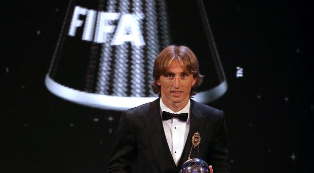 Luka Modric poses with his FIFA men's player of the year award (Tim Goode/PA)
